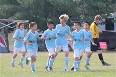Grade 5 student Jacob Oie (4th from left) and WPFC teammates