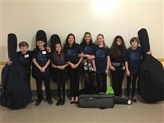 Middle School Orchestra Members (from left: Dutch, Chai, Paisley, Maya, Ella, Julia, Ela, Molly)