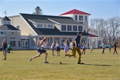 As the days warm, lacrosse sticks appear at Upper School recess.