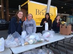 Margie Keenan '17, Allison Palmeri '17, Fiona Ismail '09 and Alex Hillenbrand '19, organize toiletries, clothing and food to be given to members of New York City's homeless community.