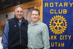 Rotary Past President Joe Rametta presents Coach Ben Ollett with PCDS's grant check for heart rate monitors