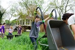 "Seventh grade students work in a ""sustainable living"" garden with Hands On Nashville."
