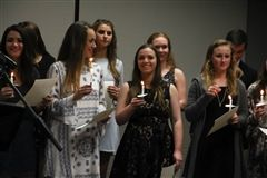 CPA inducts 80 high school students into NHS.