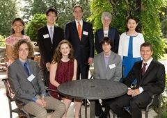Cameron Platt '12 (seated in burgundy) is honored for her academic achievement, pictured with President Christopher L. Eisgruber (standing at center) and Dean of the College Jill Dolan (standing second from right), and other award winners.
